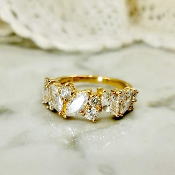 marquise diamonds in yellow gold band