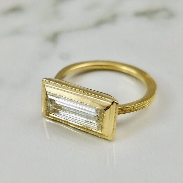 Yellow gold baguette diamond ring