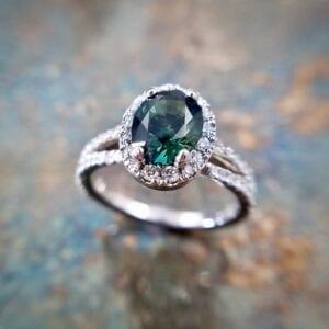 Oval sapphire diamond halo ring