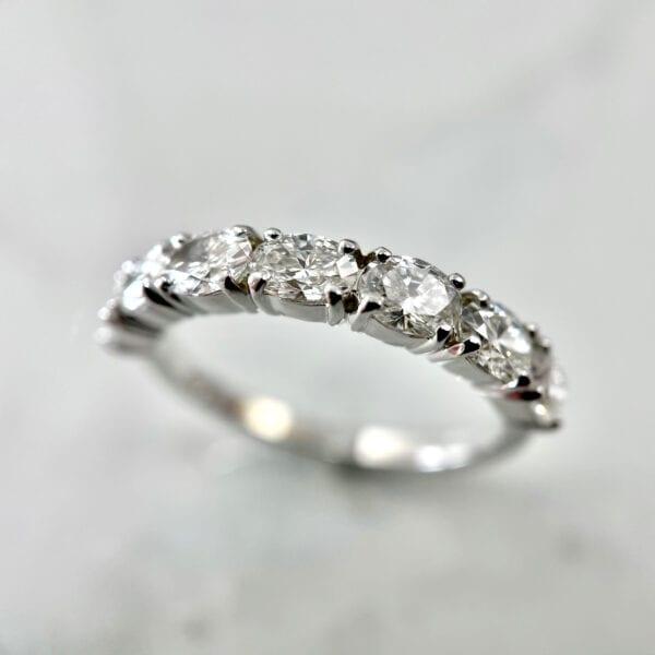 Oval diamond band prong set