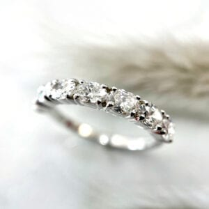 Oval prong set diamond band