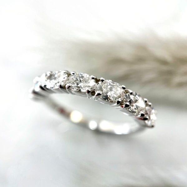 Oval prong set diamond band