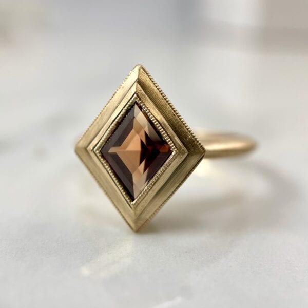 kite shaped peach sapphire ring