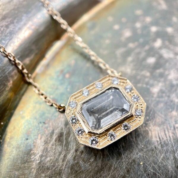 Emerald cut diamond pendant necklace