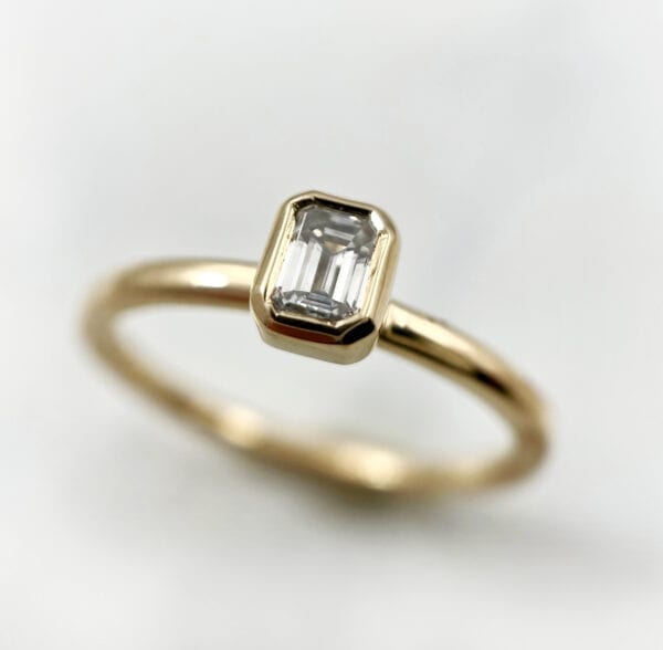 Emerald cut diamond stacking ring