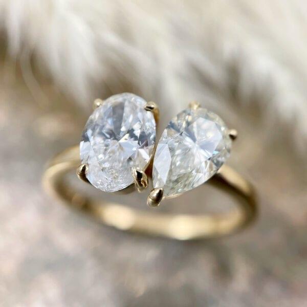 Pear oval diamond ring