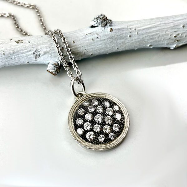 Silver diamond disc pendant necklace